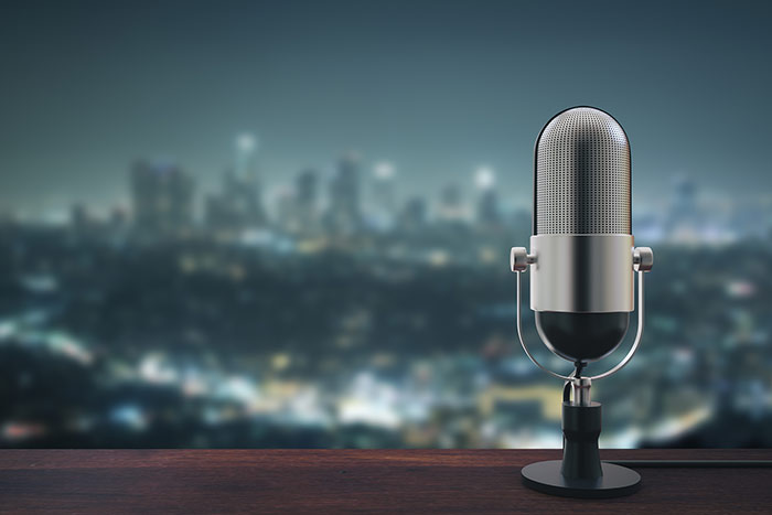 microphone with city background feat